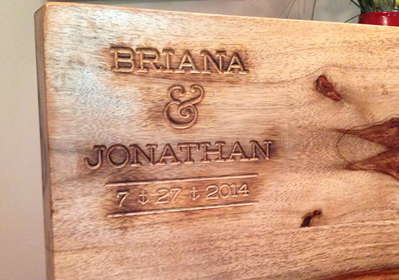 This is an engraved cutting board that I designed and created for some good friends for a wedding gift.