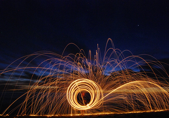 A fun picture taken on a beach in California, just after sunset. Photo is a 30 second exposure of burning steal wool